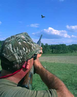 shooter aiming at flying bird